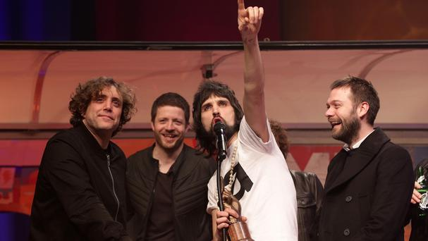 Sergio Pizzorno of Kasabian collects the Best Album Award during the NME Awards 2015.