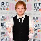 Ed Sheeran with his awards for Best British Male Solo Artist and British Album of the Year at the Brit Awards