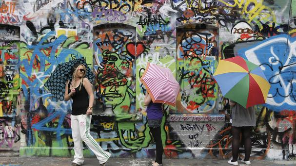 U2 fans adding their names to the graffiti on the walls of Windmill Lane Studios in Dublin