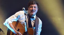 Marcus Mumford of Mumford and Sons performing on the Pyramid Stage at Glastonbury
