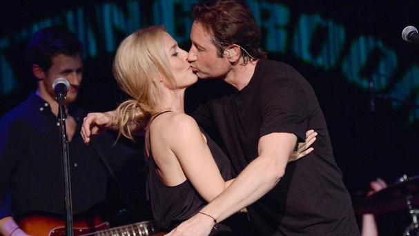 David Duchovny and Gillian Anderson shared a kiss during their performance (AP)