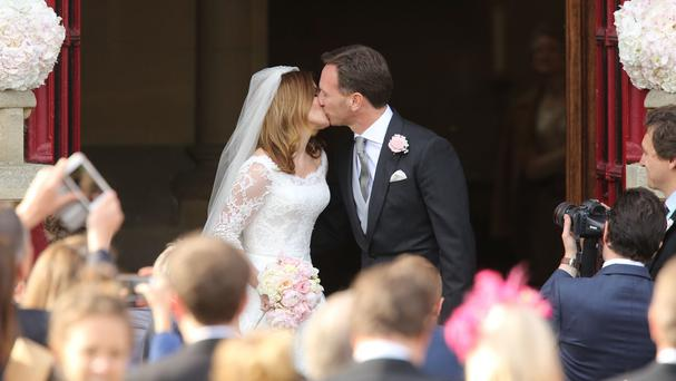 Spice Girl Geri Halliwell and her new husband Formula 1 boss Christian Horner kiss after their wedding at St Mary's Church in Woburn, Bedfordshire