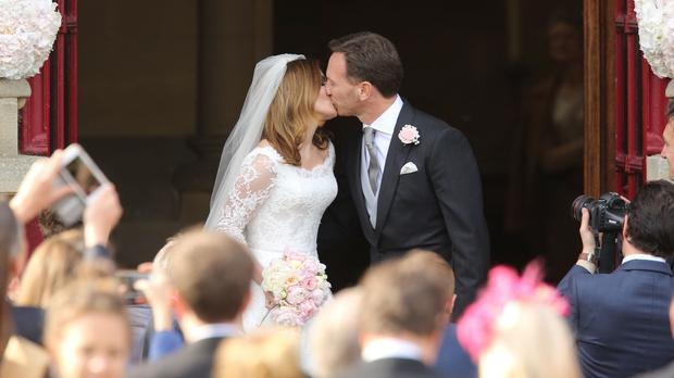 Geri Halliwell and her new husband Christian Horner share a kiss after their wedding at St Mary's Church in Woburn, Bedfordshire