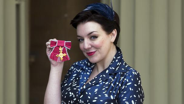 Sheridan Smith poses with her OBE for services to drama at an investiture ceremony at Buckingham Palace in London
