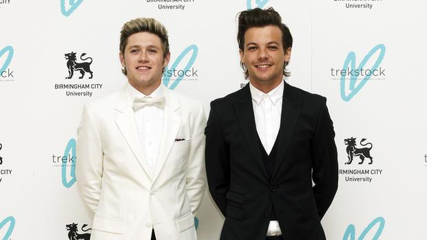 Niall Horan (left) and Louis Tomlinson