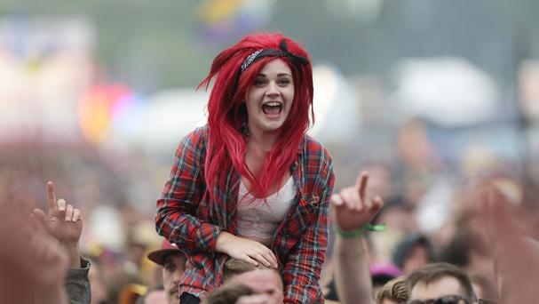 The crowd watching You Me At Six performing on the Main Stage at the Isle of Wight Festival