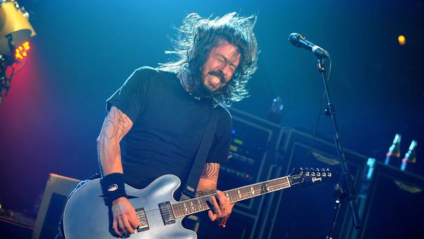 Dave Grohl of the Foo Fighters, as the US rock band have pulled out of performances at Glastonbury and Wembley Stadium after lead singer and guitarist Dave Grohl broke his leg.