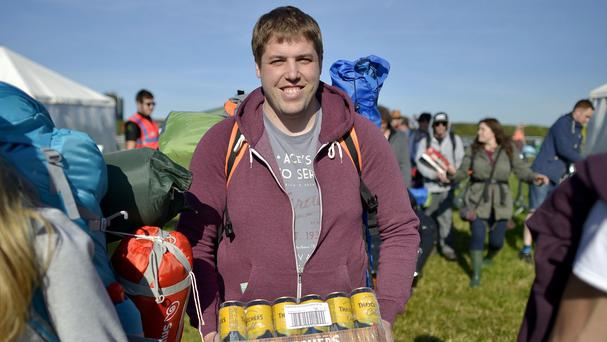 Festivalgoers arrive at the Glastonbury Festival, at Worthy Farm in Somerset