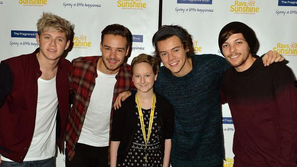 One Direction, pictured with a fan, are backing another charity campaign