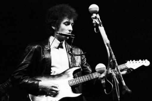 Bob Dylan onstage at the Newport Folk Festival, July 25th, 1965 playing his Fender Stratocaster electric guitar. Photo: Andew Burton