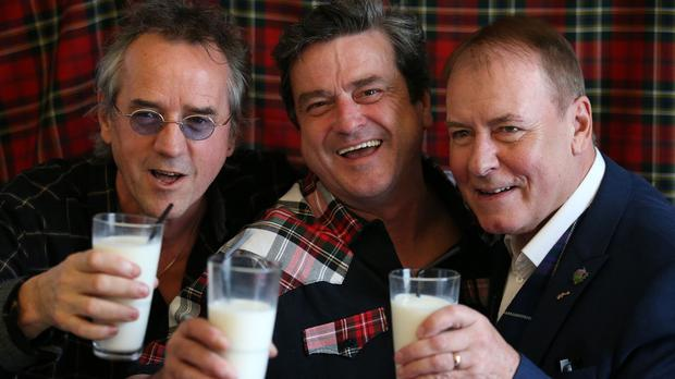 Wood, left, McKeown and Longmuir toast with milk as they make the announcement of their reunion at Central Hotel in Glasgow