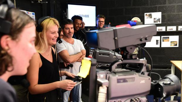 Simon Cowell visits The Brit School and the Nordoff Robbins facility onsite in London, ahead of being honoured at the Music Industry Trusts Award (MITS).