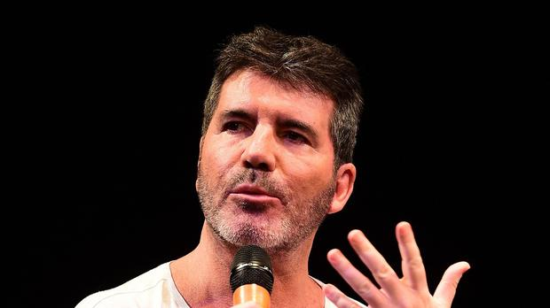 Simon Cowell has given father-to-be Louis Tomlinson some advice on dealing with parenthood