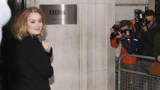 Award-winning singer Adele arrives at BBC Radio 2 for an interview about her new album