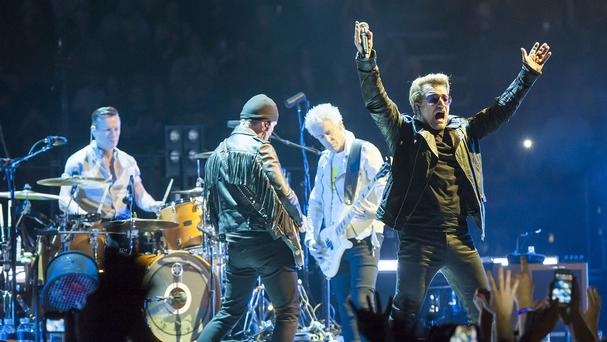 Bono gets the O2 crowd in the mood for music, kicking off U2's Innocence and Experience tour's UK gigs