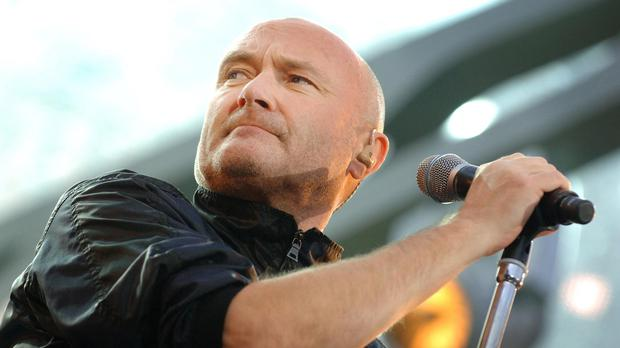 Phil Collins hits head after fall, postpones two shows