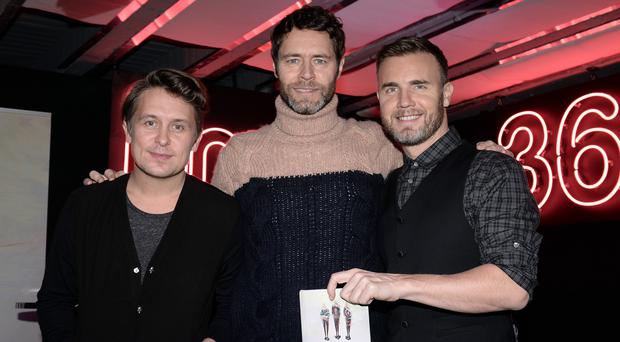 Mark Owen, Howard Donald and Gary Barlow (left to right) now make up Take That