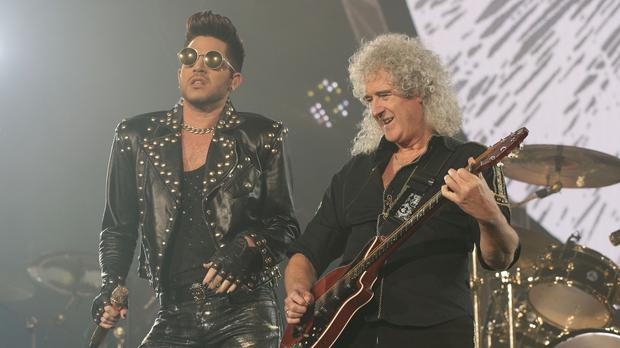 Adam Lambert (left) and Brian May will be on stage as Queen headline the Isle of Wight Festival
