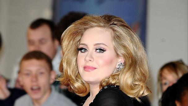 Adele debuts new single 'When We Were Young'