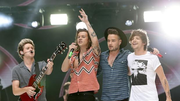 One Direction are just ahead of their Canadian rival in the race for Number One