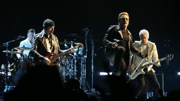 Left to right, Larry Mullen Jr, The Edge, Bono and Adam Clayton of U2 at the first of the band's homecoming gigs at the SSE Arena in Belfast
