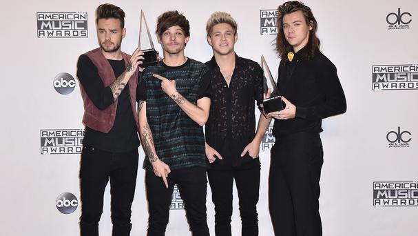 From left, Liam Payne, Louis Tomlinson, Niall Horan and Harry Styles of One Direction with their awards (Invision/AP)
