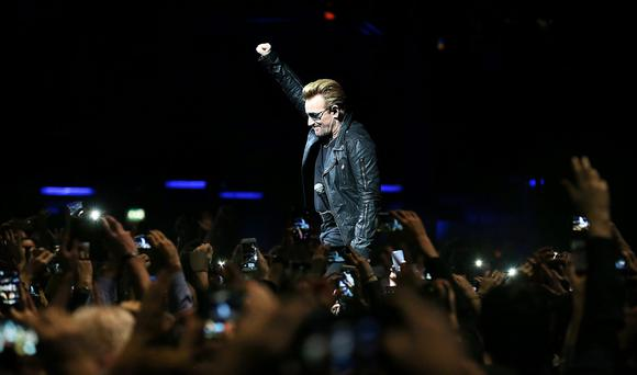 Bono on stage at the 3Arena last night. Photo: Steve Humphreys