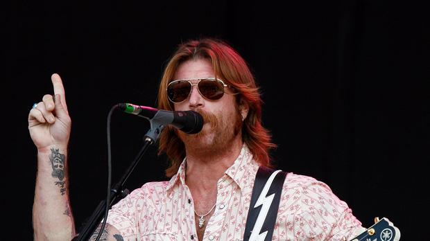 Jesse Hughes of Eagles of Death Metal told how gunmen stormed the band's gig at the Bataclan