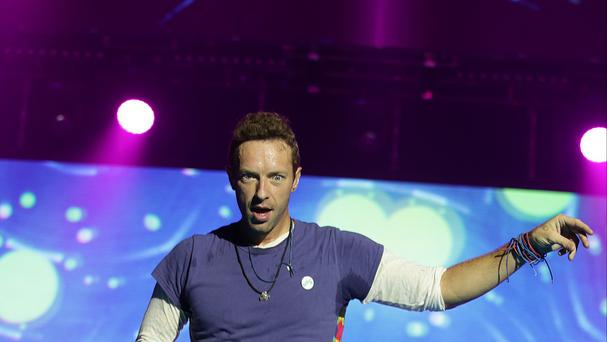 Coldplay are challenging Adele for top spot in the album charts