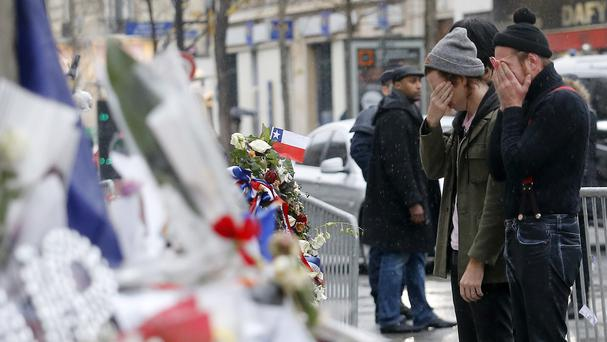 Members of Eagles of Death Metal pay their respects to 89 victims who died in the attack on the Bataclan while the band were playing (AP)