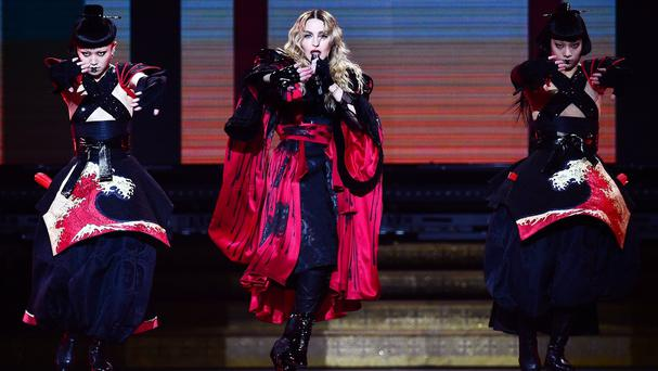 Madonna led the Glasgow crowd in an encore singalong after power was cut at the end of her concert