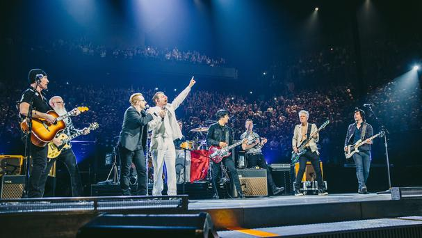 U2 performing with the Eagles Of Death Metal in Paris, less than a month after the November 13 terror atrocities (U2/PA)