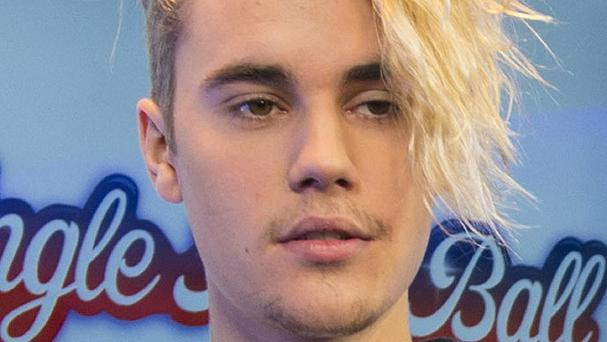 Justin Bieber has the top three spots in the singles chart