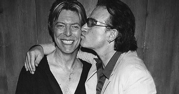 Bono puckers up to David Bowie. U2 Twitter