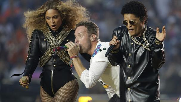 Beyonce, Chris Martin and Bruno Mars giving it their all during half-time at the Super Bowl (AP)