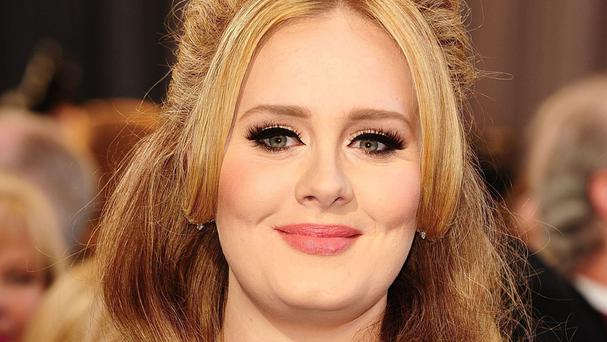 Adele takes to the stage for the Brit Awards on Wednesday