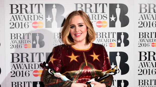 Adele with the BRIT Awards for Best British Female, Best British Album, Best British Single and Global Success Award.