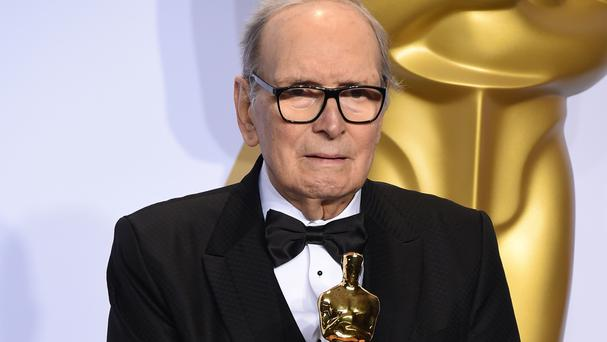 Ennio Morricone with the award for best original score for The Hateful Eight at the Oscars in Los Angeles (Jordan Strauss/Invision/AP)