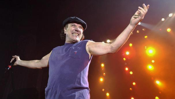AC/DC lead singer Brian Johnson performing at the Carling Hammersmith Apollo in west London
