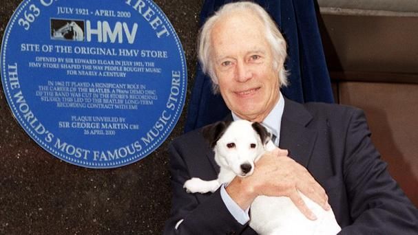 Sir George Martin pictured in 2000 with Nipper the dog at the unveiling of a plaque in Oxford Street, to record the role the HMV store played in bringing the Beatles to fame
