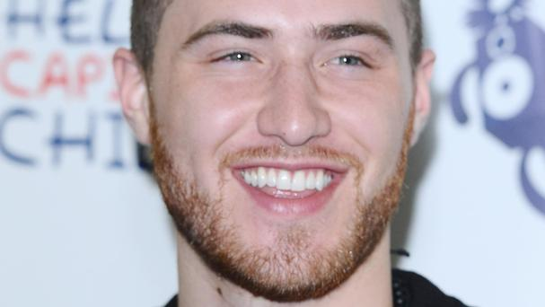 Mike Posner faces a battle to stay top of the singles chart