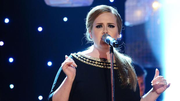 Adele remains at the top of the album chart with 25