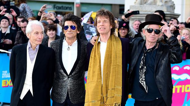 (L-R) Charlie Watts, Ronnie Wood, Mick Jagger and Keith Richards of The Rolling Stones arriving for the opening night gala for Exhibitionism: The Rolling Stones exhibition held at the Saatchi Gallery, London.