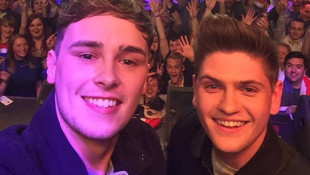 Joe Woolford and Jake Shakeshaft take a selfie on stage in Amsterdam during Eurovision In Concert 2016