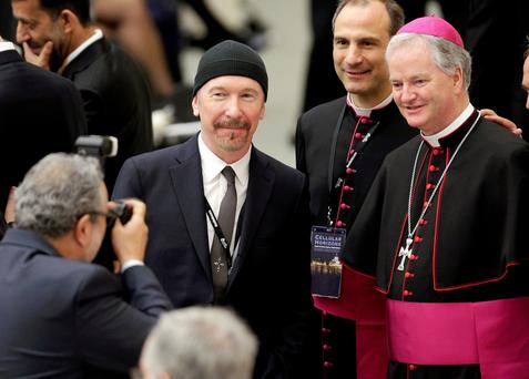 Holy show: The Edge at the Vatican last month with (right) Irish Bishop Paul Tighe.