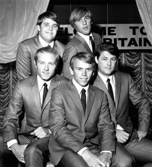 Acclaim: The Beach Boys including Brian Wilson (on right) arriving in London in November 1964. One month later Wilson quit touring and concentrated on writing the band's songs. Photo: Getty Images