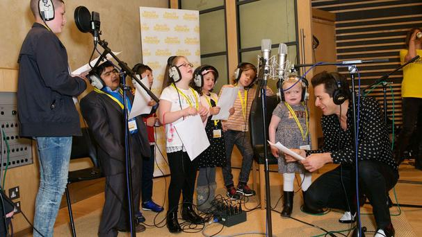 Mark Ronson with seriously ill children during a visit to Metropolis Studios in Chiswick (Ray of Sunshine Children's Charity/PA)