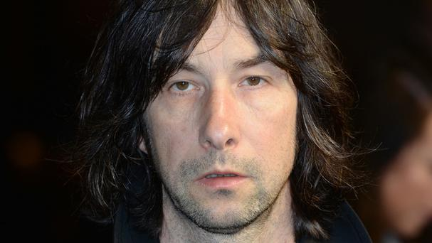 Primal Scream's Bobby Gillespie injured his back when he fell off stage at a concert