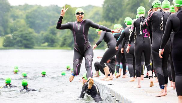 Melanie Chisholm, aka Sporty Spice, jumps for joy after completing the Blenheim Palace Triathlon in Oxfordshire, to raise money for blood cancer charity Bloodwise.