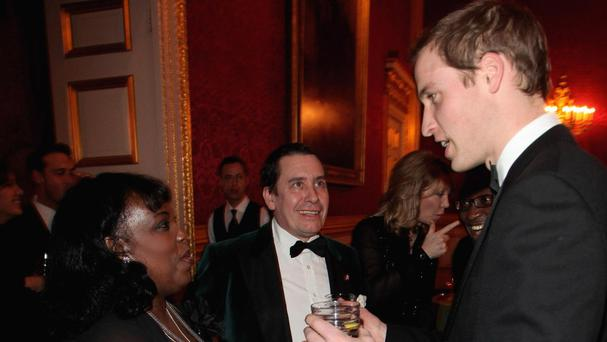 Prince William talks with Ruby Turner and Jools Holland at a dinner